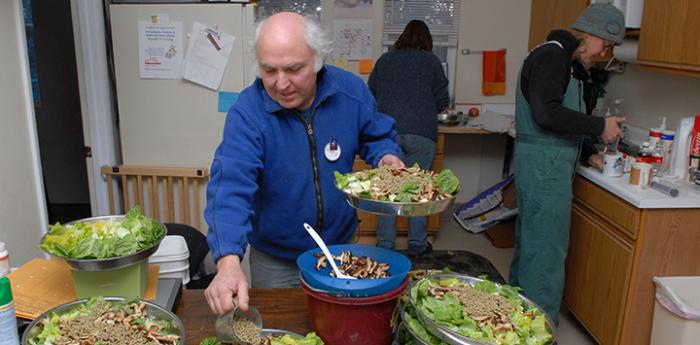 Volunteer at Piggy Paradise preparing food for the pigs