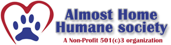 Almost Home Humane Society logo with paw print in heart
