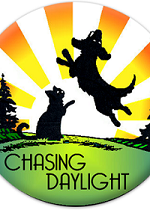 Chasing Daylight Animal Shelter (Tomah, Wisconsin) logo of cat & dog playing in sunshine