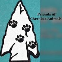 Friends of Cherokee Animals (Cherokee Village, Arkansas) logo has an arrowhead with pawprints scattered on it