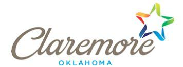 "Claremore Animal Shelter (Claremore, Oklahoma) logo ""Claremore Oklahoma"" with a rainbow-colored star"