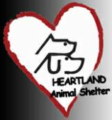 Heartland Animal Shelter (Northbrook, Illinois) logo has stacked profiles of a dog and cat inside a heart