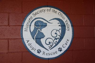 Humane Society of the Ohio Valley (Marietta, Ohio) logo dog and cat head in heart adopt rescue care