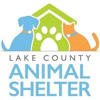 Lake County Animal Services (Tavares, Florida) logo is a dog and cat sitting next to a house with a pawprint for the door