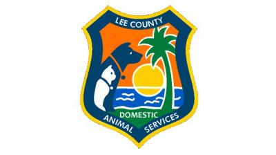 Lee County Domestic Animal Services (Fort Myers, Florida) logo dog cat palm tree sunshine in badge