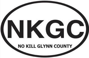 "No Kill Glynn County (St Simons Island, Georgia) logo is an oval with ""NKGC"" above the organization name in black letters inside"