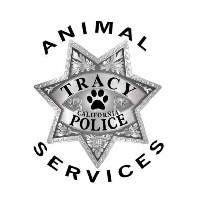 City of Tracy Animal Services (Tracy, California) logo with silver shield with black paw print