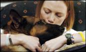 Wounded soldier Tech Sgt. Jamie Dana and her military dog, a German shepherd named Rex