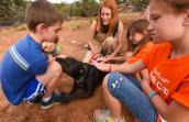 Geneva the dog loves kids and happily participates in the Best Friends Kids Camp