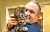 Navy veteran John Ballard with his tabby cat Diesel who he was able to keep and not surrender to the shelter