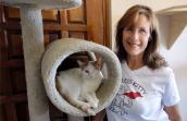 Founder of Fearless Kitty Rescue Kim Kamins with Blink the cat
