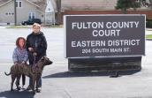 Bailey the pit bull dog and her family outside the Fulton County Court
