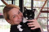 Feline intern Genevieve Hannon with tuxedo cat