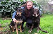 Laura Collins, who participated in Verizon's volunteer matching program to support the animals at Best Friends, and her dogs