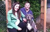 The McManuses with Schroeder the pit bull who was discriminated against