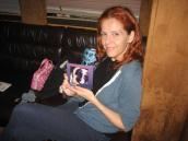 Neko Case holding a picture of a dog