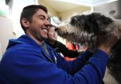Man interacting with a dog during puppy mill socialization class at Best Friends Animal Sanctuary