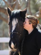 Julie kissing her adopted horse named Bonnie