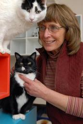 Dr. Kathy Quigley with two cats
