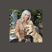 Emmylou Harris and two dogs