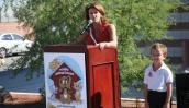 Staci Columbo speaking at Noah's Animal House opening