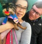 Couple with their adopted Yorkshire terrier mix dog