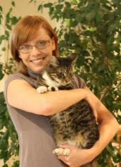 Holly Sizemore holding a tabby cat