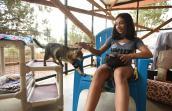 Volunteer Hailey Shah helping at Cat World