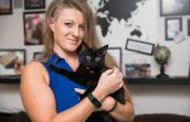 Flex the black kitten and his adopter, Tawnya Stewart