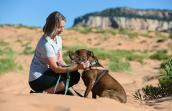 Volunteer Amber Kohnhorst at the Sanctuary with YoYo the dog