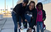 Family adopting a puppy from Detroit Animal Care and Control