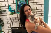 Meghan von Linden holding Knox, the Siamese FIV+ senior cat she adopted