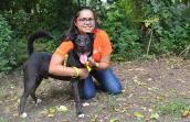 Volunteer Swarnima Singh giving a hug to Sirius, the black dog