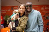 Young couple adopting a puppy at the NKLA Super Adoption event