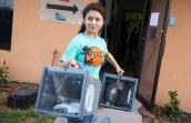 Woman from Palm Valley Animal Society holding two boxes holding cats with the intent to release them