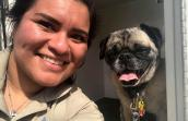 Smiling woman next to a smiling pug