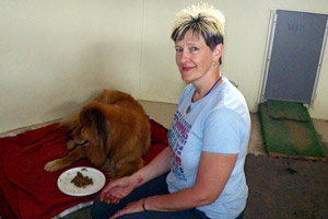 Brenda with her tattoo and the dog named Orlando