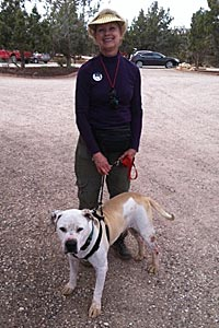 Sue Haynes walking a dog at Best Friends Animal Sanctuary