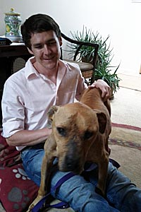 Best Friends' volunteer Zach Walker with Lucas the Vicktory dog (former Michael Vick dog)