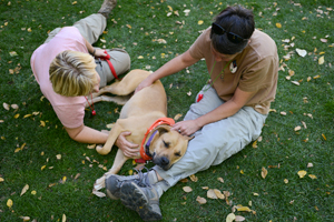 Two friends with Astrid the shy dog at Best Friends Animal Sanctuary in Southern Utah