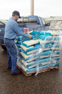 Man unloading the Blue Buffalo pet food donation in Detroit, Michigan