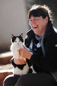Bob the legendary black-and-white cat and his new mom Monica