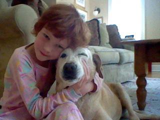 Catherine Violet Hubbard hugging a dog