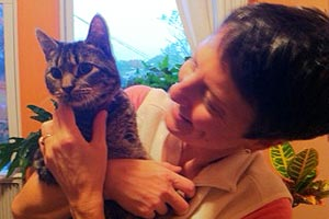 Cotton the cat with CH with his new mom at home