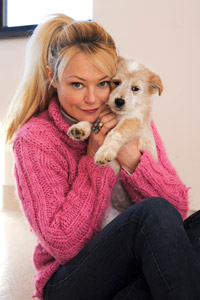 Charlotte Ross snuggling with Scone the dog
