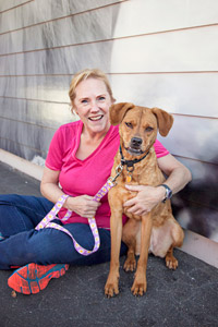 Cinnamon the dog with Angela her adopter