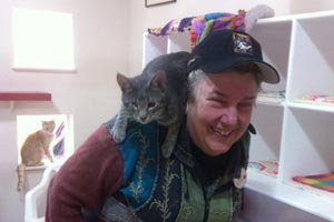 Tyresius the cat taking a ride on Liz