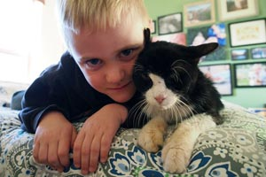 Dexter the 20-year-old cat and boy