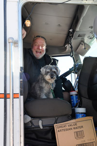 Garrett the dog with Thom in his big rig