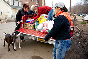 Volunteers passing out donated supplies for the animals affected by Superstorm Sandy